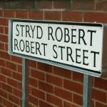 Die pressed street nameplate sign