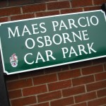 Multilingual street nameplate style sign in English and Welsh